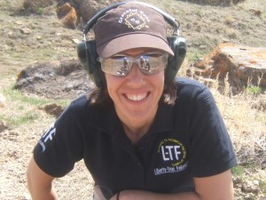 Photo of woman on shooting range with eyes and ears